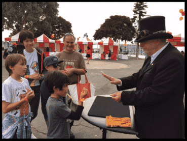"Rich"" Doc Magic"" Freeman Performing at an outdoor fair"